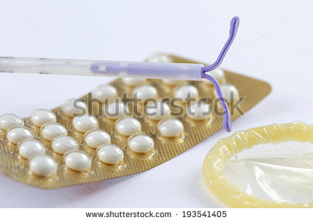 stock-photo-birth-control-symbol-iud-and-contraceptive-pills-and-condom-193541405